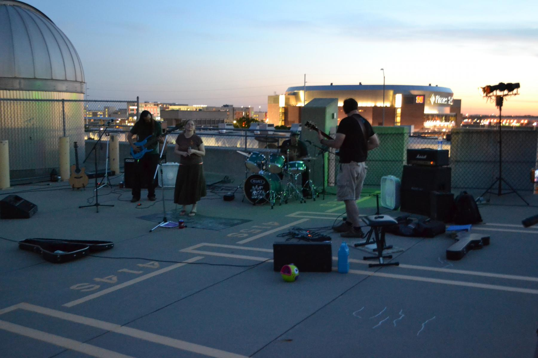Bandmembers perform next to the Student Observatory.