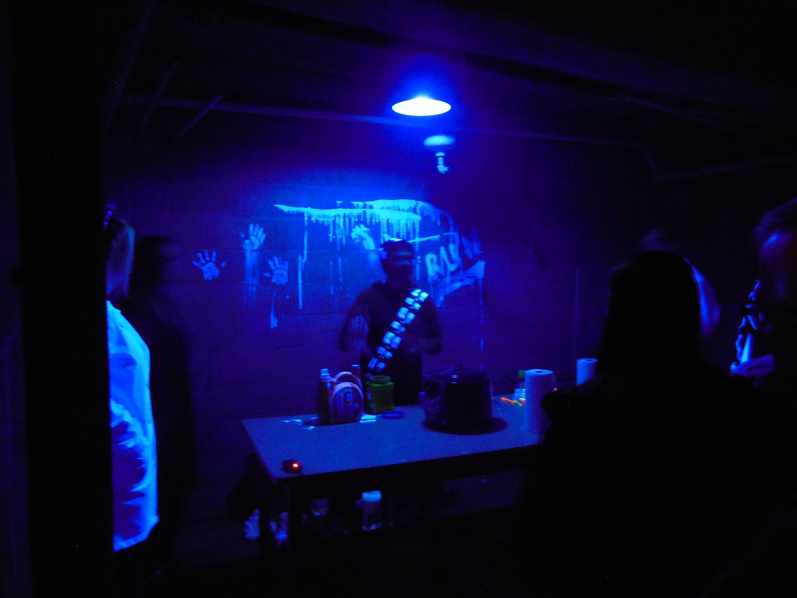 SPS student demonstrates underneath a blacklight